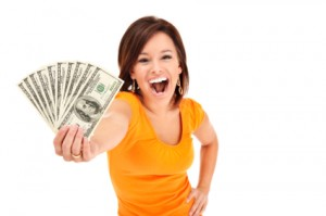 woman holding up lots of cash