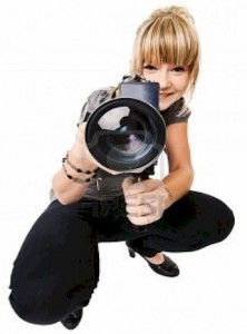 a woman-videographer-who is shooting a video
