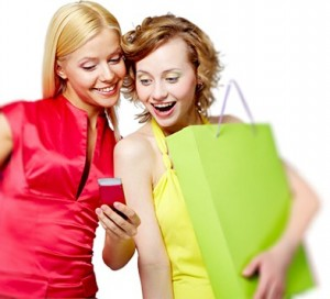 women-who are shopping in store with smartphone