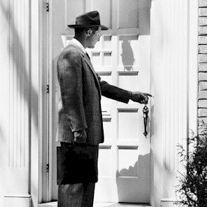 a sales man who is going door to door making cold calls