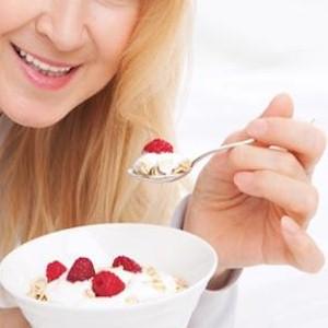 eating berries and yogurt for breakfast